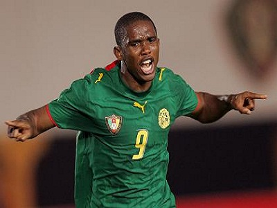 Cameroon's Eto'o celebrates goal against Angola during African Nations Cup match in Cairo