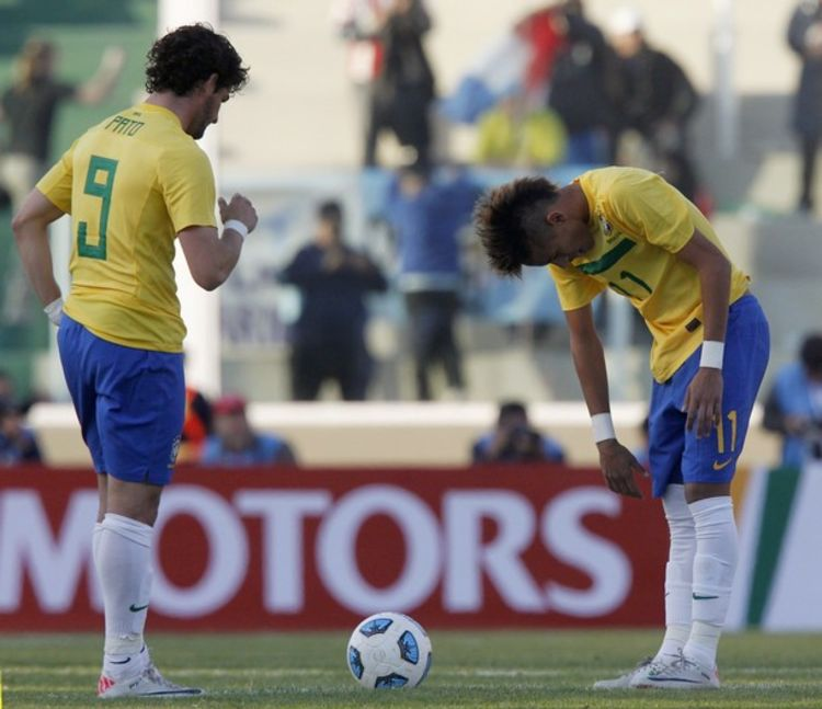 Brazil's players Pato and Neymar react after Paraguay scores a second goal during their match in the first round of the Copa America soccer tournament in Cordoba